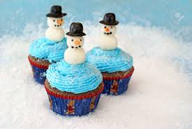 chocolate cupcakes with vanilla frosting decorated with snowmen