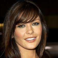 layered hairstyles with bangs and tuck behind the ears bangs hairstyles for womens hairstyles 2011