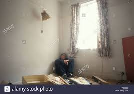 Corner Of A Room Abused Depressed Boy Sitting Alone In Corner Of Decrepid Room