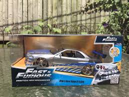 nissan r34 fast and furious brian s nissan skyline gt r r34 fast and furious blue 1 24 jada