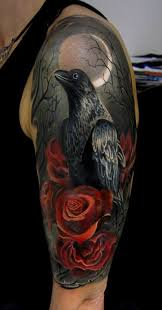 roses and crow tattoo on arm sleeve