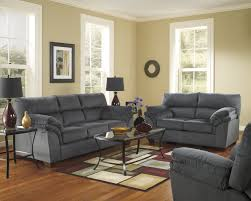 living room ideas grey couch furry green pillow rough red brick
