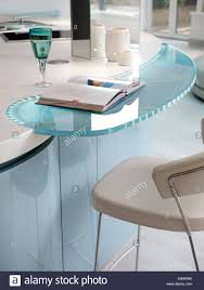detail of blue and white curved glass inset breakfast bar island