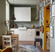white wall mounted cabinet grey chair white tile in kitchen sink