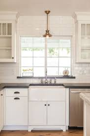 dial timer switch white tile backsplash with black brown cherry