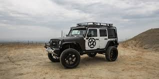 jeep white wrangler on forgiato wheels
