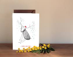 cute christmas card hand drawn reindeer with red hat