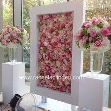 wedding backdrop flower wall instagram post by hey the wedding podcast heybride