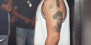 drake has a lil wayne tattoo now obviously noisey