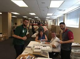 team u haul volunteers help pack veterans day cards my u haul