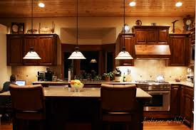 stone countertops space above kitchen cabinets lighting flooring