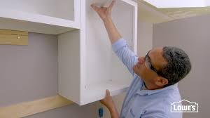 hanging upper kitchen cabinets lowe s you tube how to hang upper wall cabinets laundry room