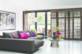Plantation Shutters For Patio Doors Shutters Wood Bifold Stained Living Room Door Jpg