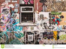 wall covered in graffiti and wallpaper murals editorial photo editorial stock photo