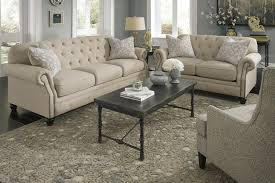 Traditional Tufted Sofa by Traditional Sofa With Tufted Back And Feather Blend Accent Pillows