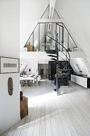 contemporary attic apartment in paris makes the most of its