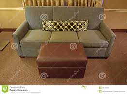 Brown Ottoman Grey Fabric Sofa With Brown Leather Ottoman And Long Narrow Pillow