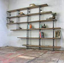 reclaimed wood bookcase with steel pipe frame white bricks