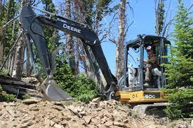 terraflow trails uses a john deere 50g compact excavator to shape