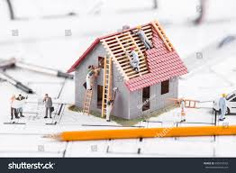 tiny people build houses architectural plans stock photo 590016542