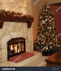 christmas tree in a cozy livingroom stock photo 62407174