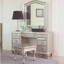 bedroom vanity table with lighted mirror and bench and makeup