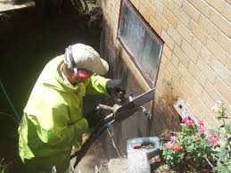 installing a basement window for egress cutting the opening