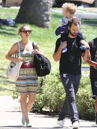 natalie portman looks summer ready in colourful dress as she