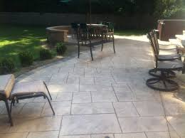 installing a stamped concrete patio over an existing patio home