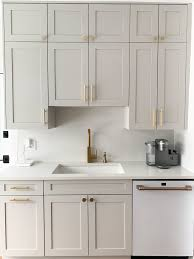 what color hardware for white kitchen cabinets greige kitchen cabinets gold hardware café matte white