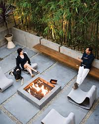 Discount Outdoor Fireplaces - modern interior with custom fireplace and concrete wall dwell 7