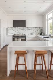 corian benchtop with polished cararra marble splashback complete