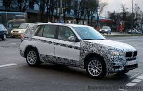 lexus lx vs bmw x5 next generation 2014 bmw x5 spotted peeling off some camo bmw news
