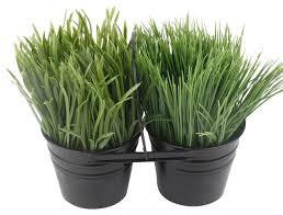 faux grass plants in black metal pot contemporary