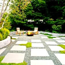 amazing black lava rock landscaping ideas with cool patio and