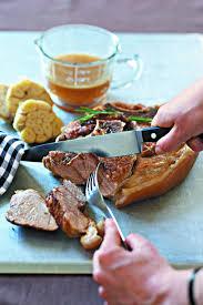 cuisiner rouelle de porc en cocotte minute recette rouelle de porc aux têtes d ail aigres douces