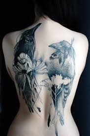 tattoo girl in the back abstract crow tattoo on girl full back