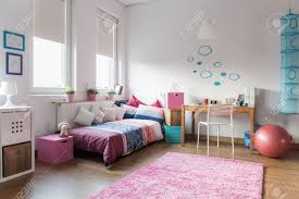 teenage girls bed teen bedroom and space for study stock photo picture and