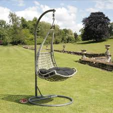 garden with outdoor hanging egg chair fits the outlook of this