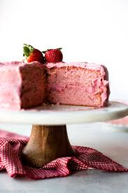 sweet strawberry cake topped with strawberry frosting made with
