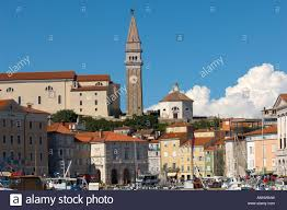 st george church above the mediterranean style houses of piran