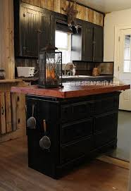 reclaimed dresser into kitchen island with pallet countertop