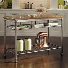 kitchen stainless steel butcher block kitchen cart with two open stainless steel butcher block kitchen cart with two open shelf and solid wood top plced on brown laminated wooden floor butcher block island cart will