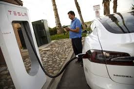 tesla charging tesla will start charging money to use its supercharging stations
