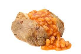 pomme de terre en robe de chambre pomme de terre en robe de chambre remplie de haricots cuits au four
