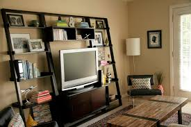 dark wood ladder bookcase with hdtv for family room decor using