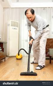 Cleaning Hardwood Floors Hardwood Distributors Asian Man Cleaning Hardwood Floor His Stock Photo 166461341