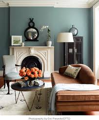 paint for living rooms muted teal walls with an orange velvet chaise coral mint