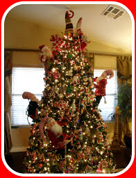 christopher radko tree with elves decorating
