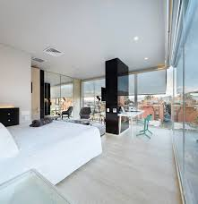 modern open bedroom apartment design with large glass window with